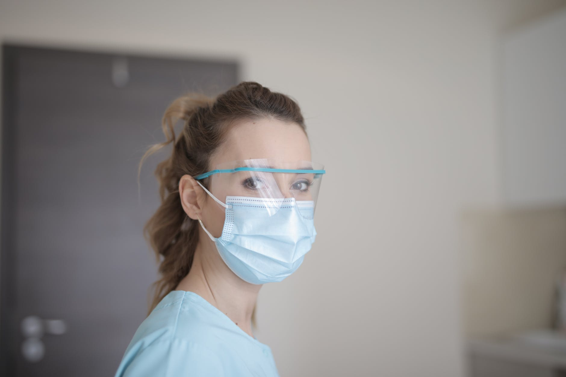 woman in blue shirt wearing face mask
